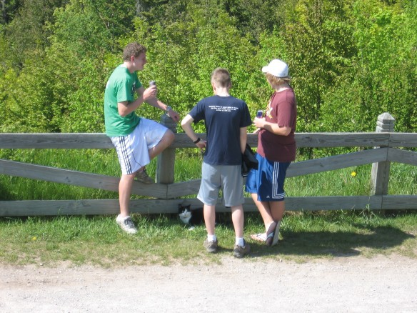 A lost cat adopted these three Boy Scouts, and followed them to Ft. Holmes.