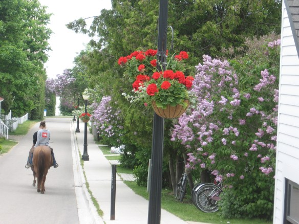 Horseback riders amble slowly down lilac-lined French Lane.