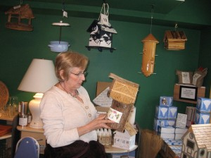 Cathie looking at birdhouses in The Grand Outlet Store.