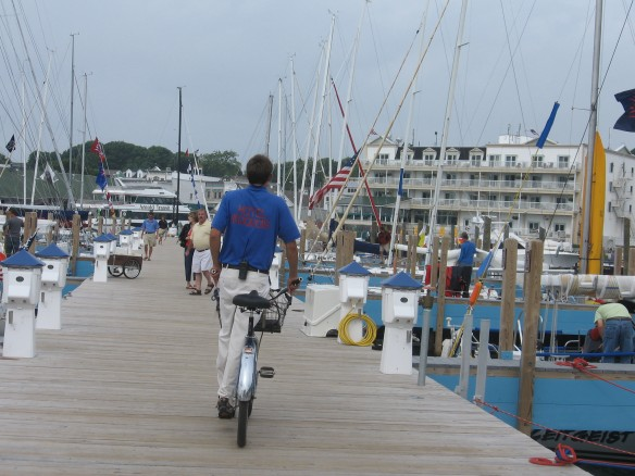 A worker rides through the marina asking if anyone needs gas, ice, lights, etc. before leaving.