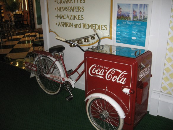 Years ago, a Grand worker would pedal this coke wagon up and down the porch of The Grand providing ice cold Coca Colas to guests.