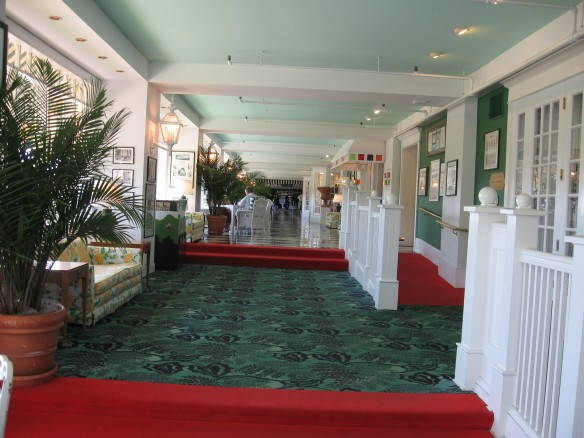 Looking down the length of The Grand's ground floor lobby all the way to the check-in desk at the far end.