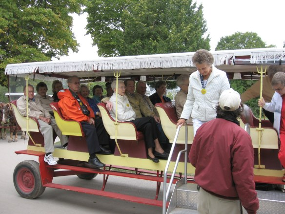 The first of four carriages carrying the tour group arrives at the Carriage Museum at Surrey Hill on Wednesday morning.