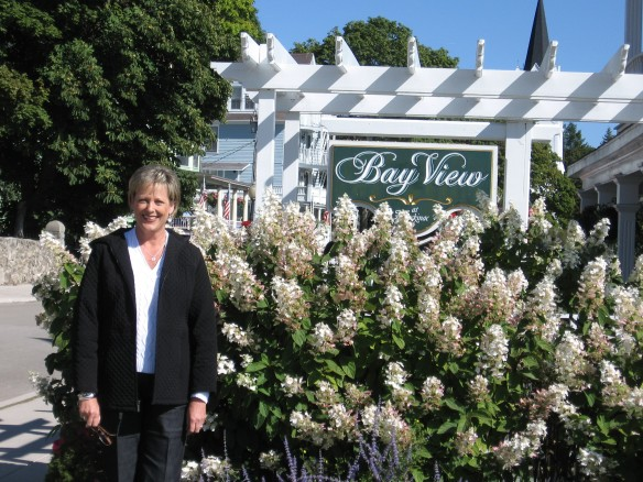 In front of the Bay View sign.  Gorgeous flowers still blooming like it is the middle of summer!