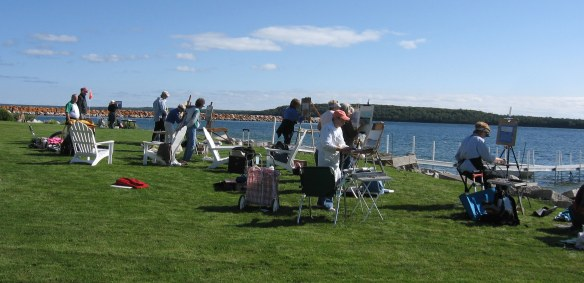A group of artists were painting down by the water in front of Leslie Court Condominiums.