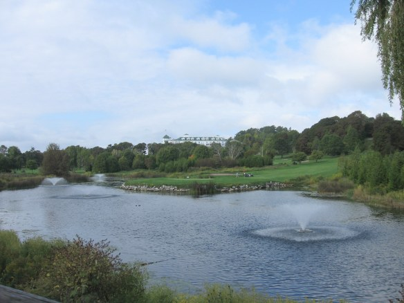 A water hazard, with the Grand in the background.
