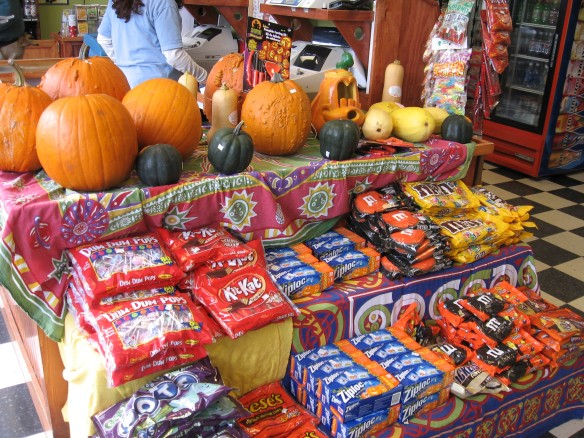 A pumpkin and Halloween candy display at Doud's Market.