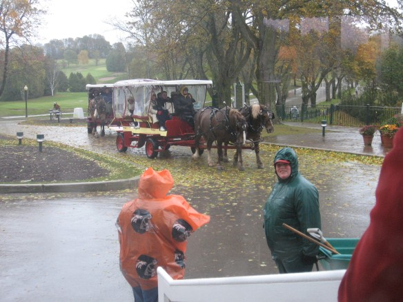 Taxis bringing passengers from the ferry docks.  That's Anna in the green rain gear.