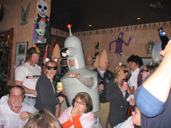 Yes, a robot.  But the funniest thing to me in this picture is the couple in the lower left corner.  They probably came to the island for a quiet weekend, not having a clue it was Halloween Crazy Night.