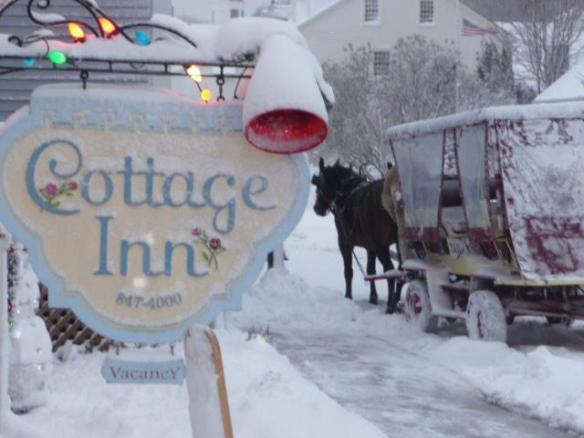 The winter's only taxi passes The Cottage Inn.  I know our friend George Wellington is driving that taxi!