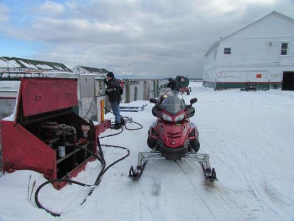 Gotta have gas for those snowmobiles, which came out of their hiding places as soon as the first dusting of snow covered the ground.  (Photo: Orietta Barquero)