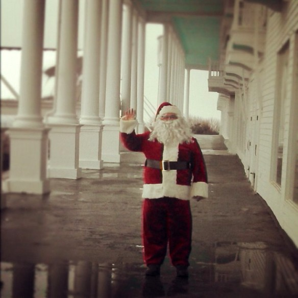 Santa arrived by firetruck on Mackinac Island this weekend.  Here he waves to the children from the porch of the Grand Hotel.  Looks like the weekend snow is almost gone now.