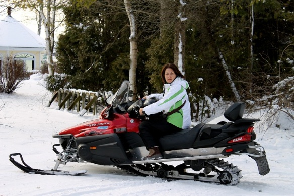 Orietta, who is from Costa Rica, is relatively new to snowmobiling.  Here she is making a tight turn out of Joan's front yard.