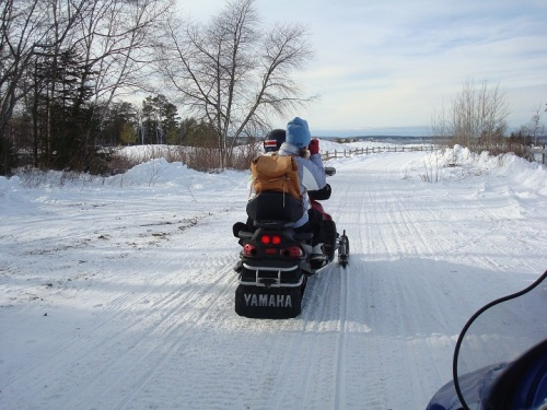 Clicking photos while riding double behind Orietta on her snowmobile on Mackinac.