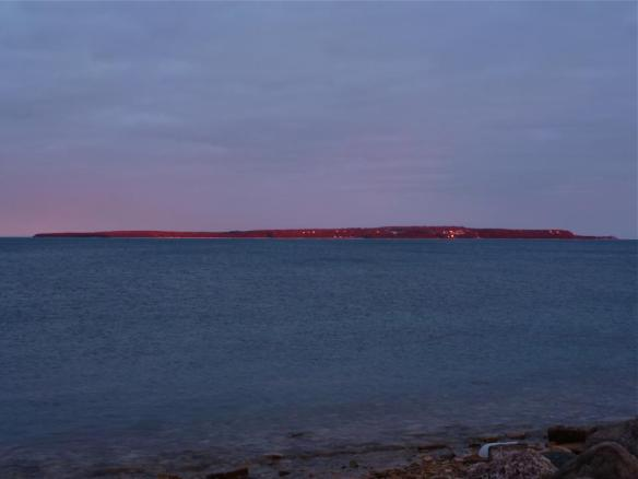 On January 9, Robert McGreevy captured this unbelievably awesome photo of our Island caught in the red glow of the sun.