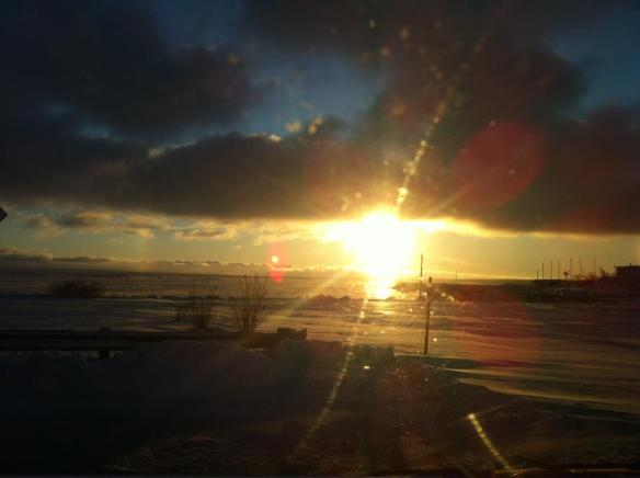 The sun rises over the ice. (Photo:  Shepler;s Ferry)