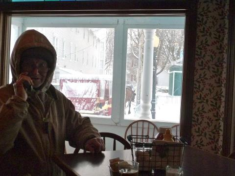 Winter taxi driver George takes a few minutes to warm up at Cawthorne's Village Inn.