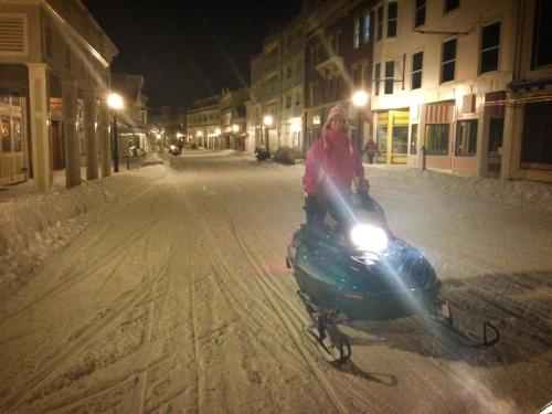 I love this photo of Diane Karkau on her snowmobile downtown.  (Photo: Travis Sred
