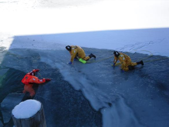 These next three photos were taken by Theodore Weeks and show out amazing Mackinac Island Fire Department during ice rescue training.