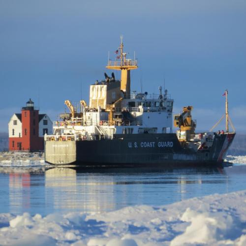 The U.S. Coast Guard Cutter Hollyhock works the ice between the lighthouses.