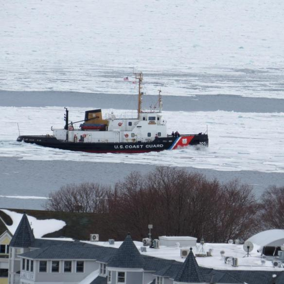 The U.S. Coast Guard Neah Bay was passing Round Island Light on a straight course to St. Ignace.