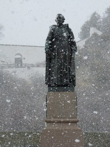 The Father Marquette statue welcomed April to the Island through a veil of snow flakes.