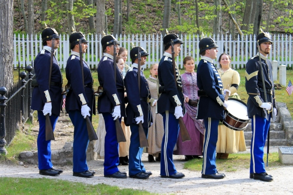 The soldiers and ladies then march solemnly from the cemetery and return to Fort Mackinac.