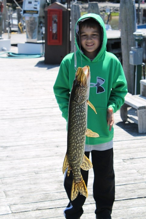 Now I don't know too much about fish, but this little boy was VERY excited when he pulled this one in. The funny thing was, after he landed it, he didn't want anything to do with it - wouldn't even hold the line so I could get his picture . . .