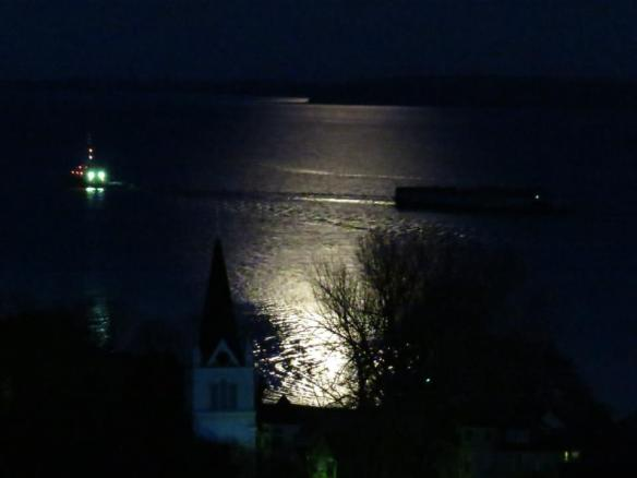 A tug and barge headed for Soo Ontario under the light of a full moon. (Photo: Clark Bloswick)