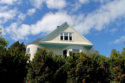 A cottage against the blue sky . . .