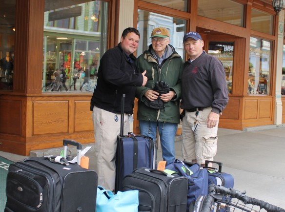 """When they checked out this morning, Josh Carley and Archie Horn wanted their photos taken with Lowell.  Both were born and raised on the Island and love anyone who can tell stories about the """"good old days""""."""
