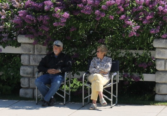 This couple had a choice spot to watch the parade - right in the shade - and sweet smell - of beautiful Lilacs!
