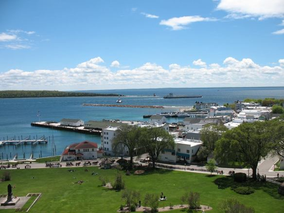 Overlooking the city of Mackinac Island with the Straits of Mackinac lighthouses and a freighter in the distance - from Fort Mackinac.