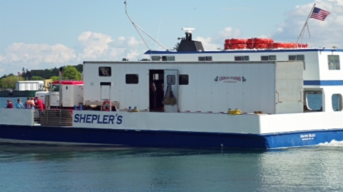 What can you see inside the open door of Shepler's Sacre Bleu - their freight boat?