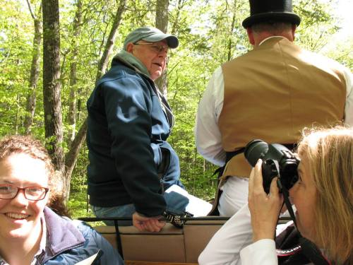 Ted riding shotgun with Ben as Brenda gets their picture.  Stephanie the Town Crier reporter is at the left.