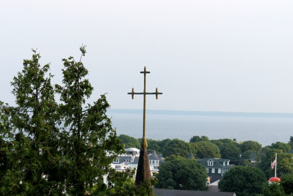 The Trinity Episcopal Church steeple cross, as seen from Fort Mackinac.