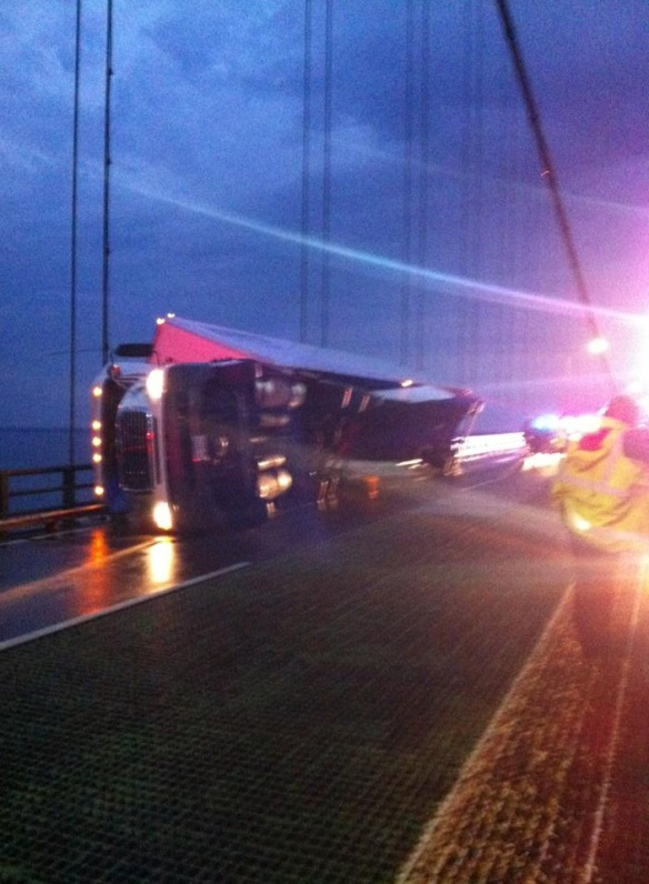 Mike Godi posted this pic from another angle.  The bridge was closed until nearly 1 a.m. this morning, while emergency crews worked to clear the lane.  Thankfully, the driver was not badly injured, but he sure was shaken up!