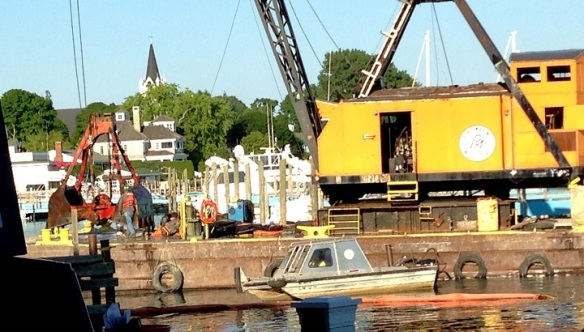 The size of the bucket was amazing (you can see the man standing beside it).  I have no idea how many thousands of pounds of silt was removed and placed on the barge where the crane rested.  Another amazement was the tiny little tug boat maneuvering that huge barge.