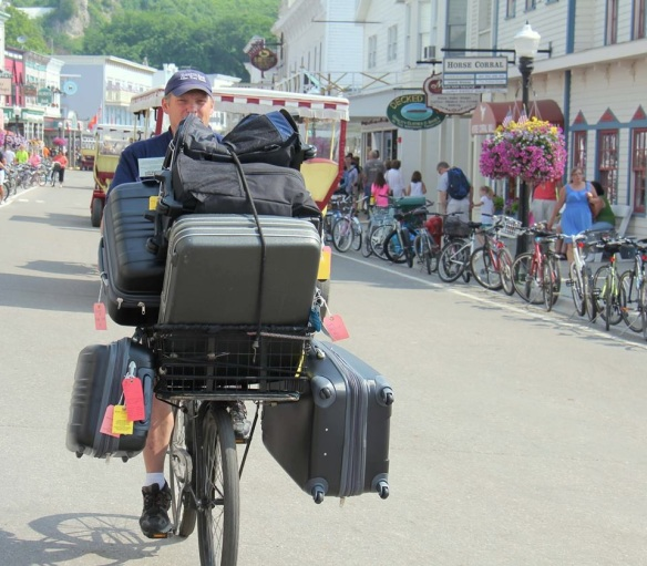 One of our favorite dock porters, Archie Horn, showing how baggage handing is done - Mackinac style!