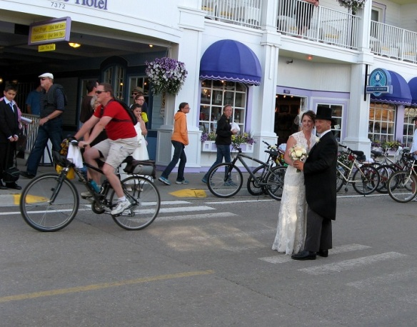 Where else but on Mackinac can a new bride and groom step out into the middle of the street for wedding photos!