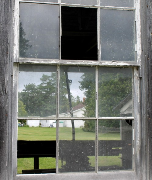 Take one old, broken window in a wooden barn still standing among the State Park maintenance buildings . . .