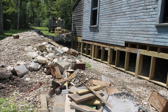 Those three men dug out - by hand - the rock and dirt under each of the two cabins . . . .