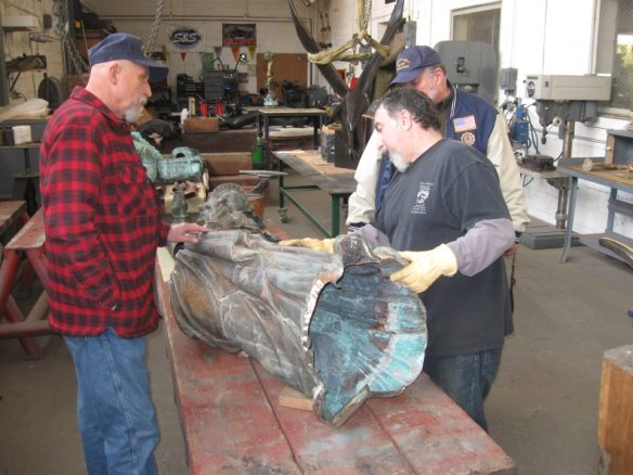 On April 1, 2013 myself and my 2 brothers visited with the Statue of Liberty Replica in Detroit.  Giorgio Gikas, President of Venus Bronze Works was our tour guide around his shop.  Getting to see the statue was the reason why we were there.  This picture shows some of the work done.  Since he is preparing to solder the sections back together he must insure that these sections are perfectly cleaned.  The bottom portion will be attached to a brand new base that will be made of bronze.