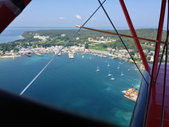 Thank you, Brad Conkey, for being brave enough to go up in the Red Baron, a bi-plane giving flights over the Island this summer.  What a view!  We can even see our condos behind the Grand Hotel!