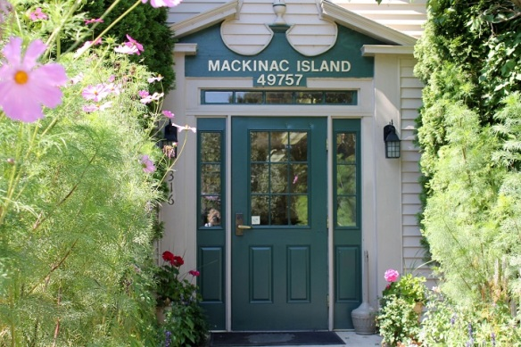 The Mackinac Island Post Office front door - framed by flowers.