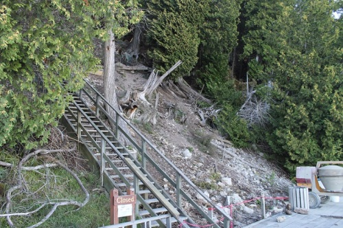 If you're one of those visitors who doesn't think your trip to Mackinac is complete unless you've climbed the steps from M-185 to Arch Rock (or vice-versa), you probably know the steps were partially destroyed by a late snow and ice storm in the spring of 2012.  It's taken almost a year-and-a-half to repair them (they are redoing ALL the steps, not just those wiped out by trees in the storm).