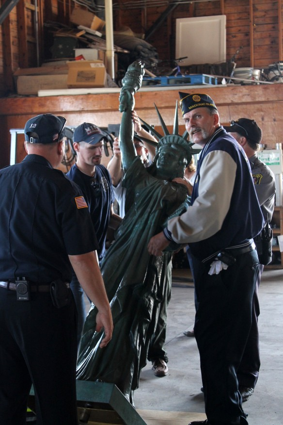 The Honor Guard gently lifted the statue . . .