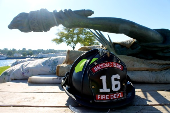 One of the firemen laid his helmet next to her