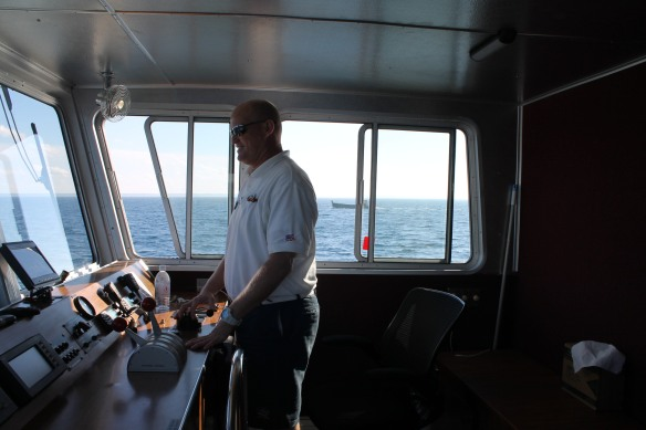 Chris Shepler piloted us across the Straits as other vessels began to fall into place with the Sacre Bleu.