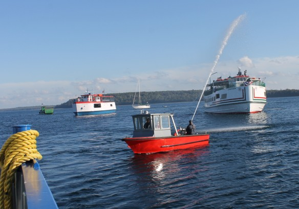 . . . joined by the spray from the Mackinac Island fire boat.